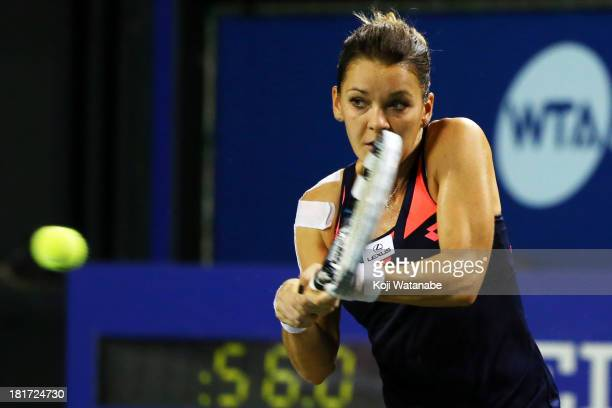 Agnieszka Radwanska of Poland in action during her women's singles second round match against Aleksandra Wozniak of Canada during day three of the...