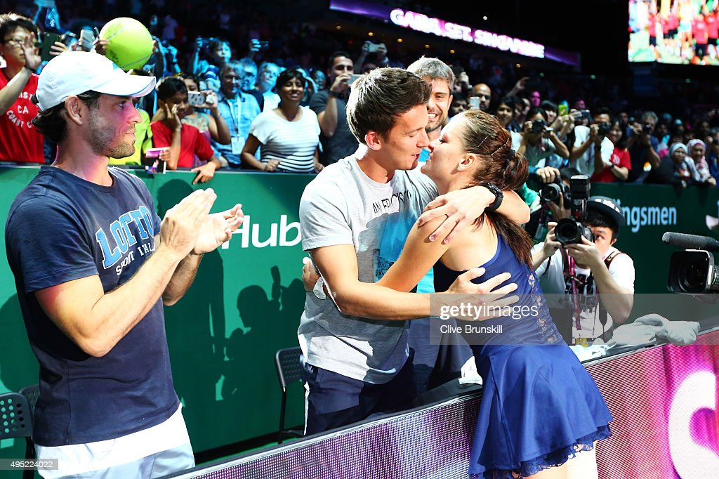 Agnieszka Radwanska of Poland is congratulated by friends and family after defeating Petra Kvitova of Czech Republic in the final match during the BNP Paribas WTA Finals at Singapore Sports Hub on November 1, 2015 in Singapore.