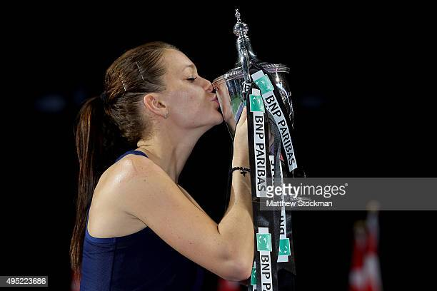 Agnieszka Radwanska of Poland kisses the Billie Jean King Trophy after defeating Petra Kvitova of Czech Republic in the final match during the BNP...