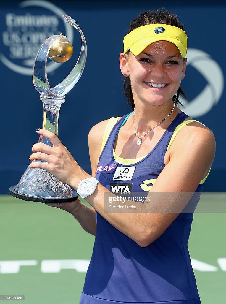 Agnieszka Radwanska of Poland kisses the trophy after defeating Venus Williams of the USA during the women's finals match at Uniprix Stadium on August 10, 2014 in Montreal, Canada.