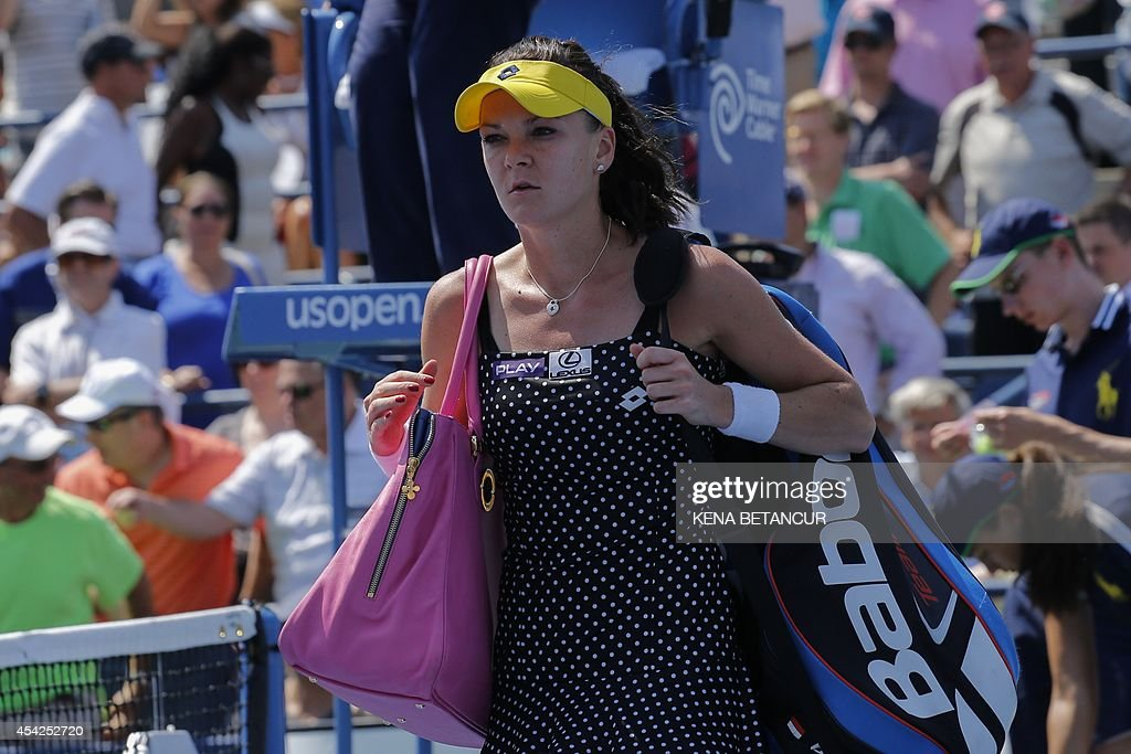Agnieszka Radwanska of Poland leaves the court after losing to Peng Shuai of China during the 2014 US Open women's singles match at the USTA Billie Jean King National Tennis Center August 27, 2014 in New York. AFP PHOTO/Kena Betancur