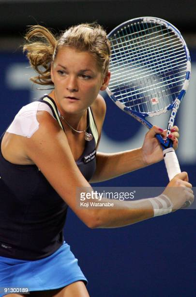 Agnieszka Radwanska of Poland looks on in her match against Magdalena Rybarikova of Slovakia during day five of the Toray Pan Pacific Open Tennis...