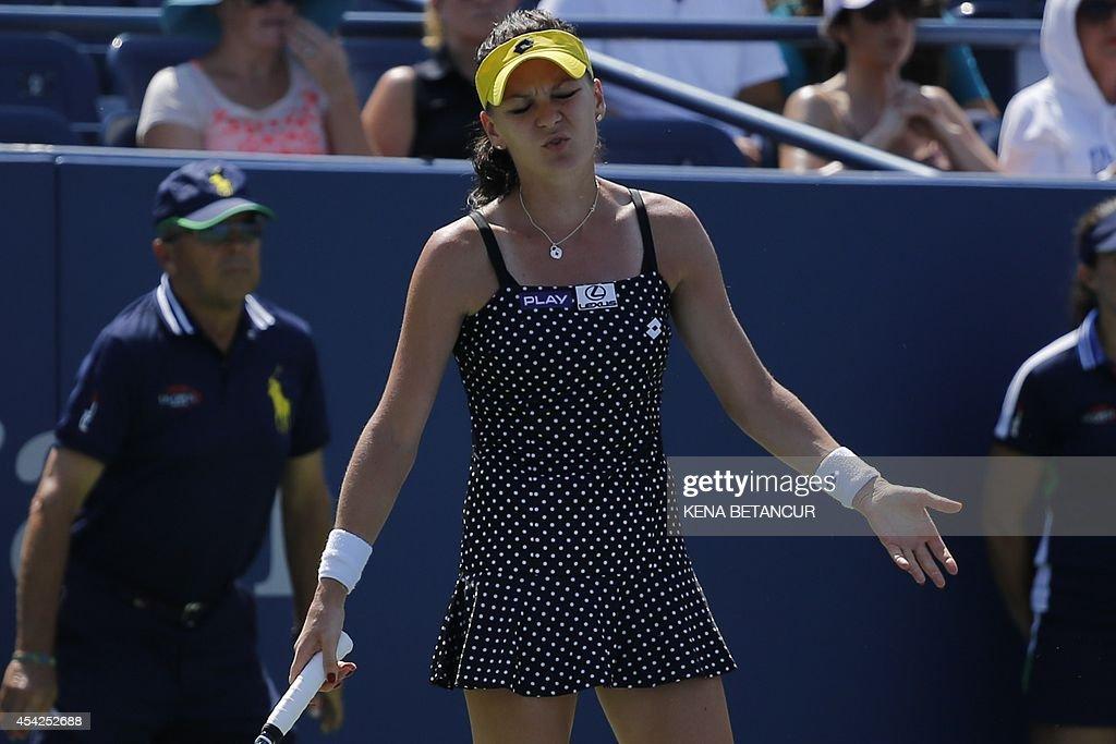 Agnieszka Radwanska of Poland misses a shot to Peng Shuai of China during the 2014 US Open women's singles match at the USTA Billie Jean King National Tennis Center August 27, 2014 in New York. Peng won 6-3, 6-4. AFP PHOTO/Kena Betancur