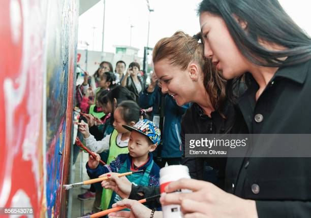 Agnieszka Radwanska of Poland paints on a wall during the Little Painter event on day three of the 2017 China Open at the China National Tennis...