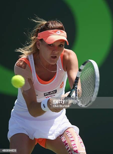 Agnieszka Radwanska of Poland plays a backhand against Dominika Cibulkova of Slovakia during their quarter final round match during day 10 at the...