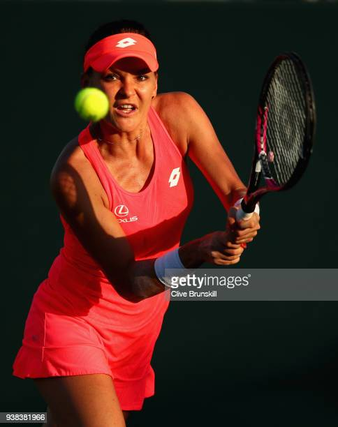 Agnieszka Radwanska of Poland plays a backhand against Victoria Azarenka of Belarus in their fourth round match during the Miami Open Presented by...