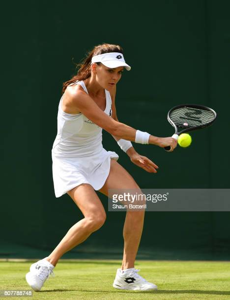 Agnieszka Radwanska of Poland plays a backhand during the Ladies Singles first round match against Jelena Jankovic of Serbia on day two of the...