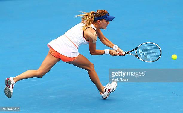Agnieszka Radwanska of Poland plays a backhand in her second round match against Bethanie MattekSands of the USA during day three of the 2014 Sydney...