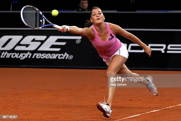 Agnieszka Radwanska of Poland plays a forehand during her second round match against Shahar Peer of Israel at day three of the WTA Porsche Tennis...