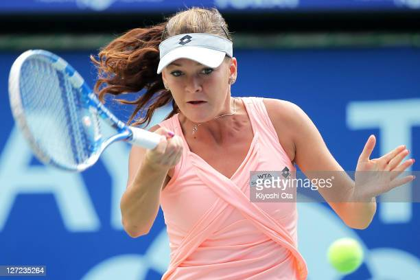 Agnieszka Radwanska of Poland plays a forehand in her match against Angelique Kerber of Germany during the day three of the Toray Pan Pacific Open at...