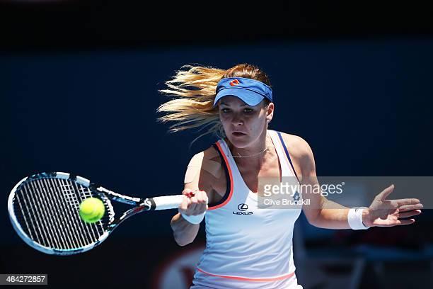 Agnieszka Radwanska of Poland plays a forehand in her quarterfinal match against Victoria Azarenka of Belarus during day 10 of the 2014 Australian...