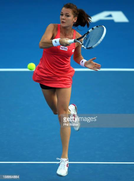 Agnieszka Radwanska of Poland plays a forehand in her second round match against Simona Halep of Romania during day three of the 2013 ASB Classic on...