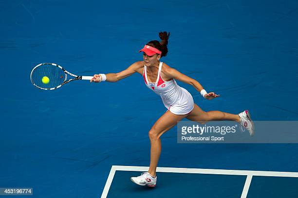 Agnieszka Radwanska of Poland plays a forehand in her third round match against Heather Watson of Great Britain during day five of the 2013...