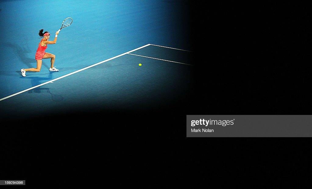 Agnieszka Radwanska of Poland plays a forehand in the final against Dominika Cibulkova of Slovakia during day six of the Sydney International at Sydney Olympic Park Tennis Centre on January 11, 2013 in Sydney, Australia.