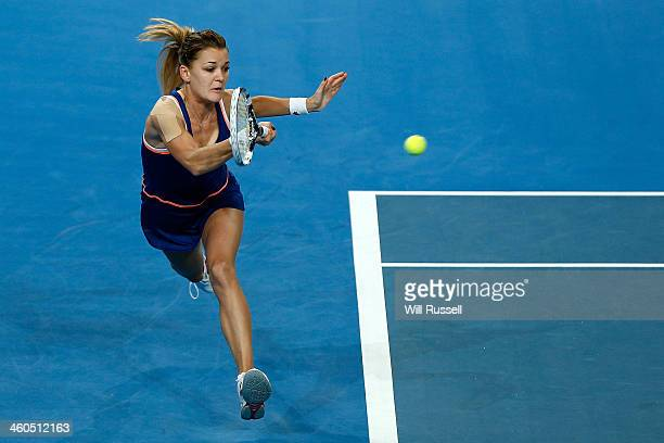 Agnieszka Radwanska of Poland plays a forehand in the women's singles match against Alize Cornet of France during day eight of the Hopman Cup at...