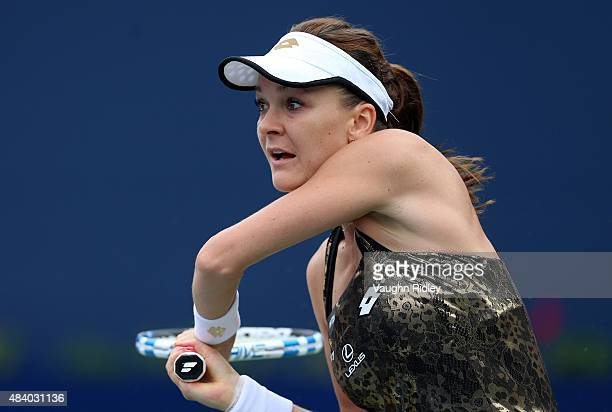 Agnieszka Radwanska of Poland plays a shot against Simona Halep of Romania during Day 5 of the Rogers Cup at the Aviva Centre on August 14 2015 in...