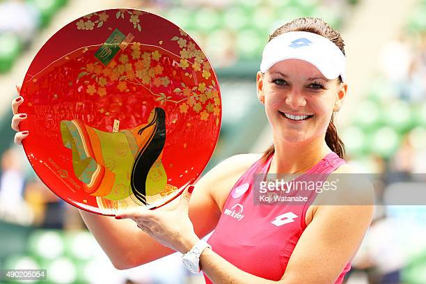 Agnieszka Radwanska of Poland poses for a photograph after winning against Belinda Bencic of Switzerland during day 7 of women's single final the...
