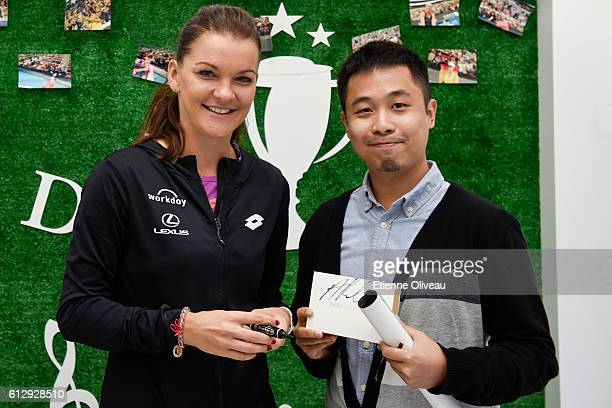 Agnieszka Radwanska of Poland poses with a fan at the LeMobile booth on day six of the 2016 China Open at the China National Tennis Centre on October...