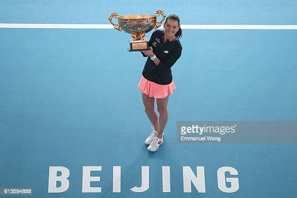 Agnieszka Radwanska of Poland poses with her trophy after winning the the Womens's singles final match against Johanna Konta of Great Britain on day...