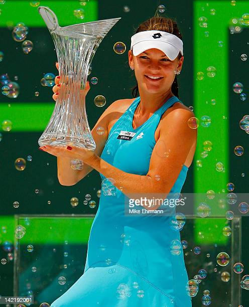 Agnieszka Radwanska of Poland poses with the trophy after beating Maria Sharapova of Russia during the women's final of the Sony Ericsson Open at...