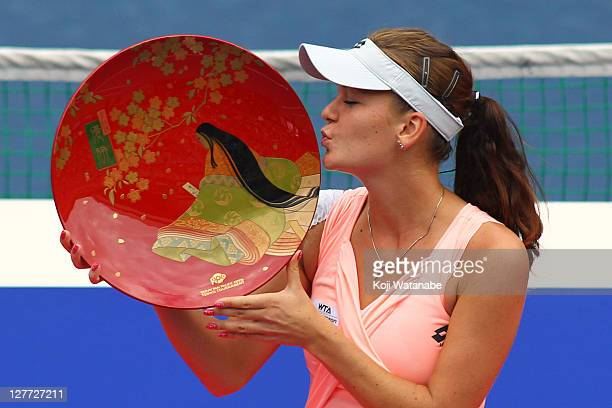 Agnieszka Radwanska of Poland poses with the trophy after winning the women's final match against Vera Zvonareva of Russia during the day seven of...