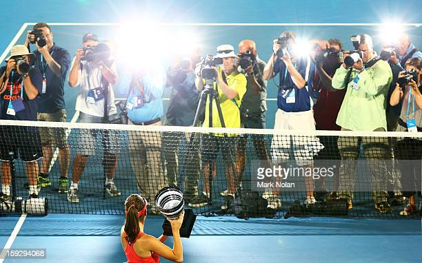 Agnieszka Radwanska of Poland poses with the winners trophy after winning the final against Dominika Cibulkova of Slovakia during day six of the...