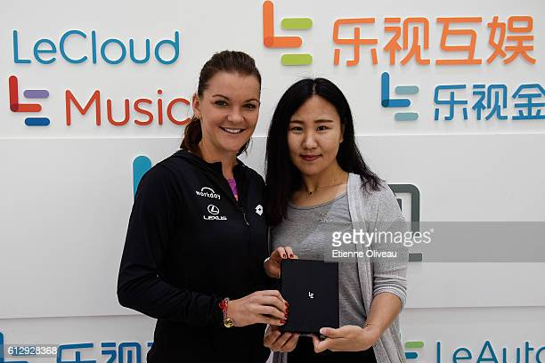 Agnieszka Radwanska of Poland receives a gift at the LeMobile booth on day six of the 2016 China Open at the China National Tennis Centre on October...