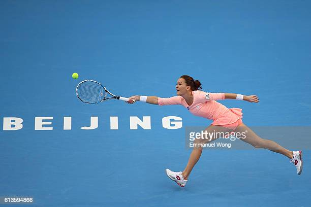 Agnieszka Radwanska of Poland returns a shot against Johanna Konta of Great Britain during the the Womens's singles final match on day 9 of the 2016...