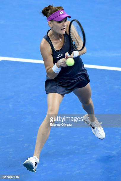 Agnieszka Radwanska of Poland returns a shot against Zhang Shuai of China during their Women's single second round match on day four of the 2017...