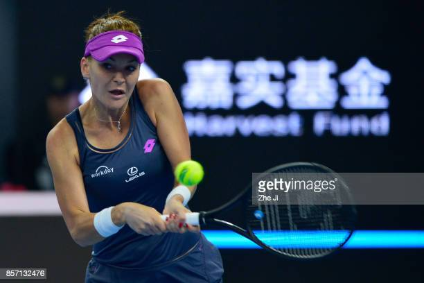 Agnieszka Radwanska of Poland returns a shot against Zhang Shuai of China during the women's singles second round on day four of 2017 China Open at...