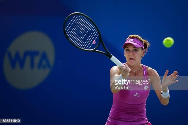 Agnieszka Radwanska of Poland returns a shot during the match against Magdalena Rybarikova of Slovakia on Day 2 of 2017 Dongfeng Motor Wuhan Open at...