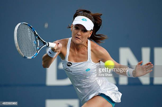 Agnieszka Radwanska of Poland returns a shot to Angelique Kerber of Germany during Day 5 of the Bank of the West Classic at Stanford University Taube...