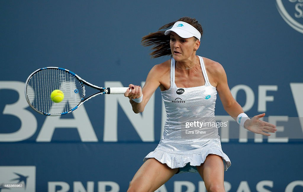 Agnieszka Radwanska of Poland returns a shot to Angelique Kerber of Germany during Day 5 of the Bank of the West Classic at Stanford University Taube Family Tennis Stadium on August 7, 2015 in Stanford, California.