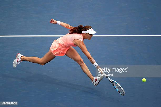 Agnieszka Radwanska of Poland returns a shot to Caroline Garcia of France during her third round Women's Singles match on Day Six of the 2016 US Open...