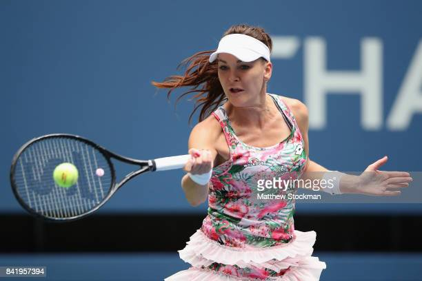 Agnieszka Radwanska of Poland returns a shot to CoCo Vandeweghe of the United States during their third round Women's Single's match on Day Six of...