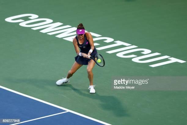 Agnieszka Radwanska of Poland returns a shot to Daria Gavrilova of Australia during Day 7 of the Connecticut Open at Connecticut Tennis Center at...