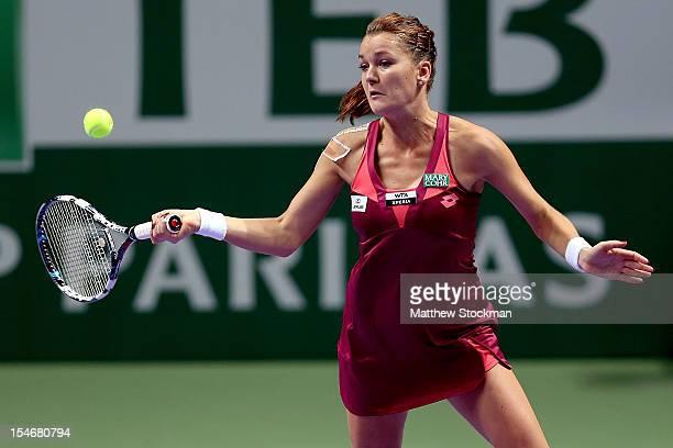 Agnieszka Radwanska of Poland returns a shot to Maria Sharapova of Russia in round robin play during the TEB BNP Paribas WTA Championships at the...
