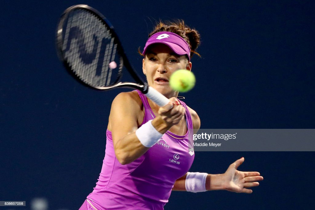 Agnieszka Radwanska of Poland returns a shot to Shuai Peng of China during their match on Day 7 of the Connecticut Open at Connecticut Tennis Center at Yale on August 24, 2017 in New Haven, Connecticut.
