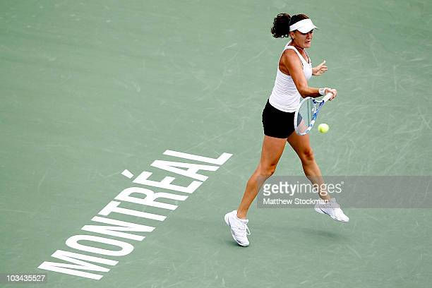 Agnieszka Radwanska of Poland returns a shot to Vania King of the United States during the Rogers Cup at Stade Uniprix on August 18, 2010 in...