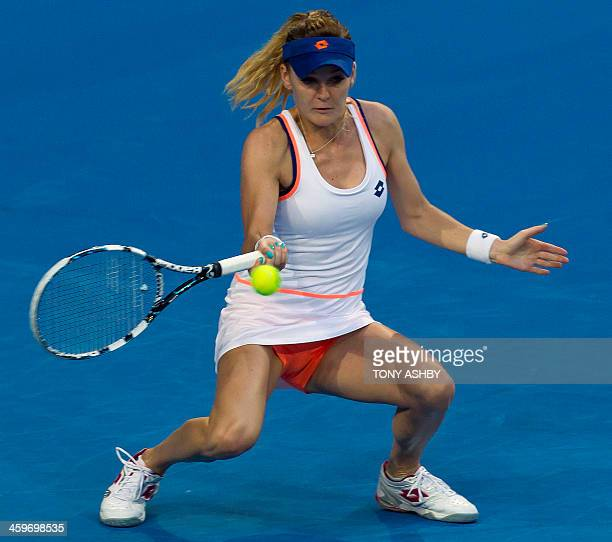 Agnieszka Radwanska of Poland returns against Eugenie Bouchard of Canada during their fourth session women's singles match on day two of the Hopman...