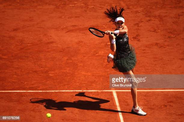 Agnieszka Radwanska of Poland returns the ball during the ladies singles second round match against Alsion Van Uytvanck of Belgium on day five of the...