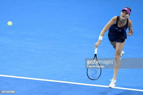 Agnieszka Radwanska of Poland serves against Zhang Shuai of China during their Women's single second round match on day four of the 2017 China Open...
