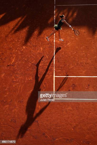 Agnieszka Radwanska of Poland serves during the ladies singles first round match against Fiona Ferro of France on day three of the 2017 French Open...