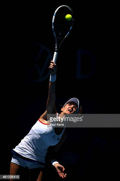 Agnieszka Radwanska of Poland serves in her singles match against Alize Cornet of France during day six of the 2015 Hopman Cup at Perth Arena on...