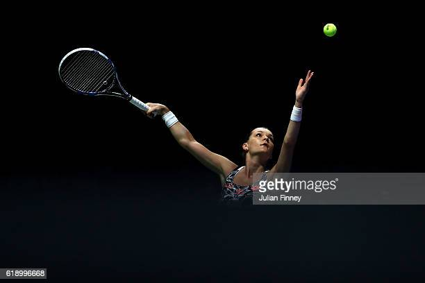 Agnieszka Radwanska of Poland serves in her singles semi-final match against Angelique Kerber of Germany during day 7 of the BNP Paribas WTA Finals...