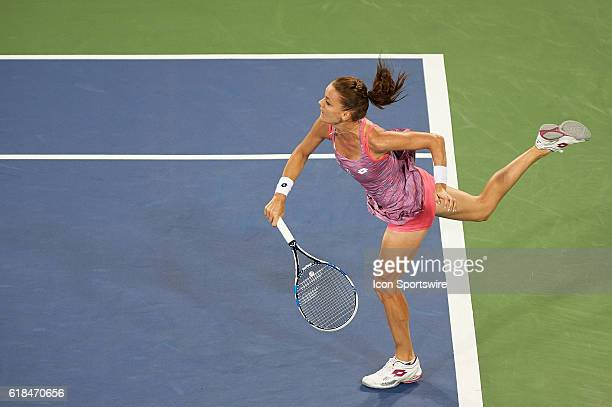 Agnieszka Radwanska of Poland serves the ball to Simona Halep of Romania during the Western and Southern Open at the Lindner Family Tennis Center in...