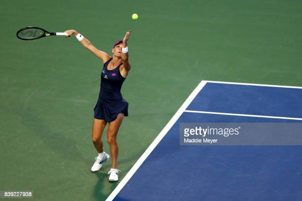 Agnieszka Radwanska of Poland serves to Daria Gavrilova of Australia during Day 7 of the Connecticut Open at Connecticut Tennis Center at Yale on...