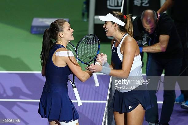 Agnieszka Radwanska of Poland shakes hands with Garbine Muguruza of Spain after defeating her in the semifinal match during BNP Paribas WTA Finals at...