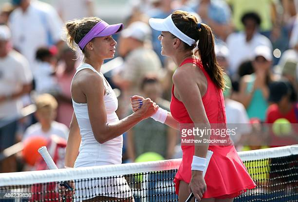 Agnieszka Radwanska of Poland shakes hands with Magda Linette of Poland in their Women's Singles Second Round match on Day Three of the 2015 US Open...