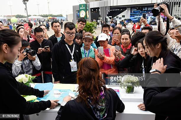 Agnieszka Radwanska of Poland signs autographs at the LeMobile booth on day six of the 2016 China Open at the China National Tennis Centre on October...
